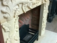 Bespoke Hand-Carved Stone Fireplace with Acorn Artwork 11