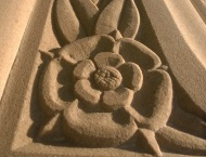 Close Up of Handcarved Stone Fireplace Art