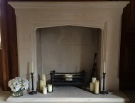 Hand-carved stone fireplace